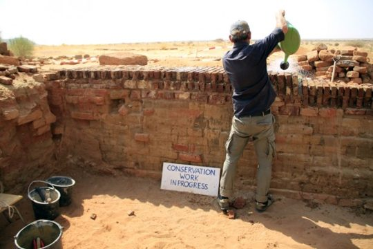 P.Ortiz during conservation work in the Temple of Amun