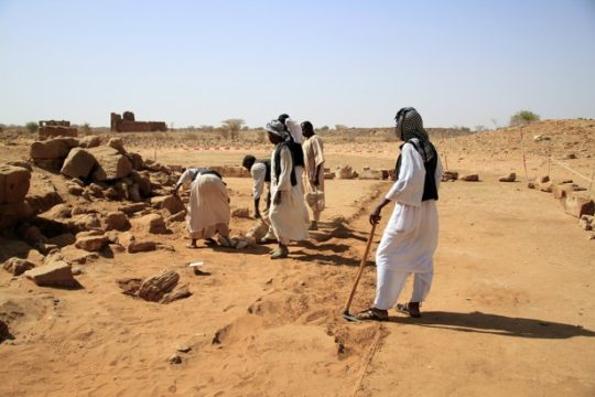 Sudanese workers excavating Temple 1200