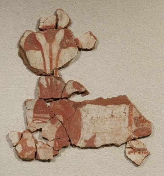Fragment of a painting showing a fertility god